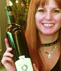 Sherry Martin displaying a bottle of Karlo Estates wine