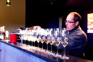 Pouring L'Acadie sparkling Prestige Brut for Uncork Nova Scotia Wine Tours.
